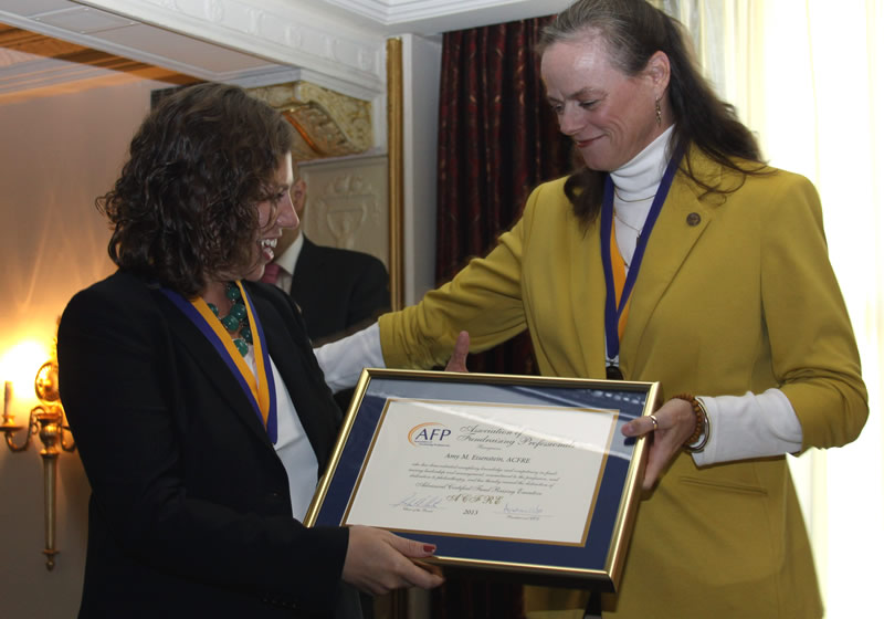 Amy being presented her ACFRE certificate